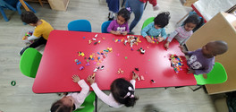 The children actively partake in the alphabet recognition activity