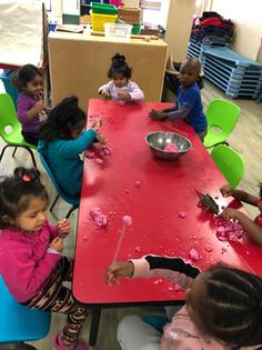 Playdough Time! The children are making dinosaur footprints