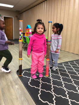 Using their critical thinking skills, the children participate in cooperative play with sensory tubes