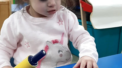 Child R engaging in sensory play