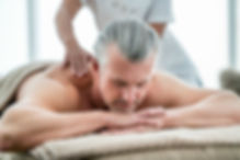 older-man-getting-a-massage-gettyimages-