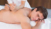 Brunette male full back massage.jpg