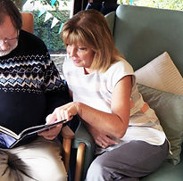 Care support worker reading to a client .jpg
