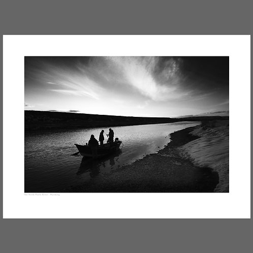 A fine art black and white photograph of fly fishermen on the North Platte river in Wyoming