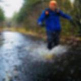 dictator_running_through_water.jpg