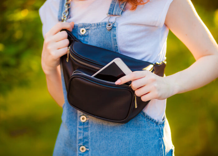 Woman with smartphone and fanny pack