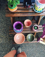 We have hand-crafted  pottery vendors at