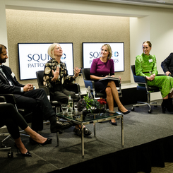 Louisa leads a panel discussion at Squir