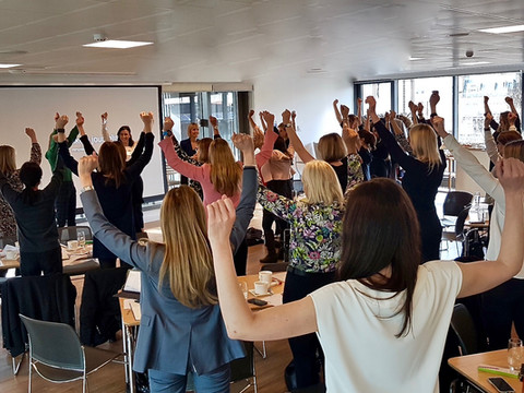 Practising the Power Pose with attendees