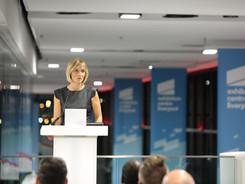 Louisa presenting a corporate event in L