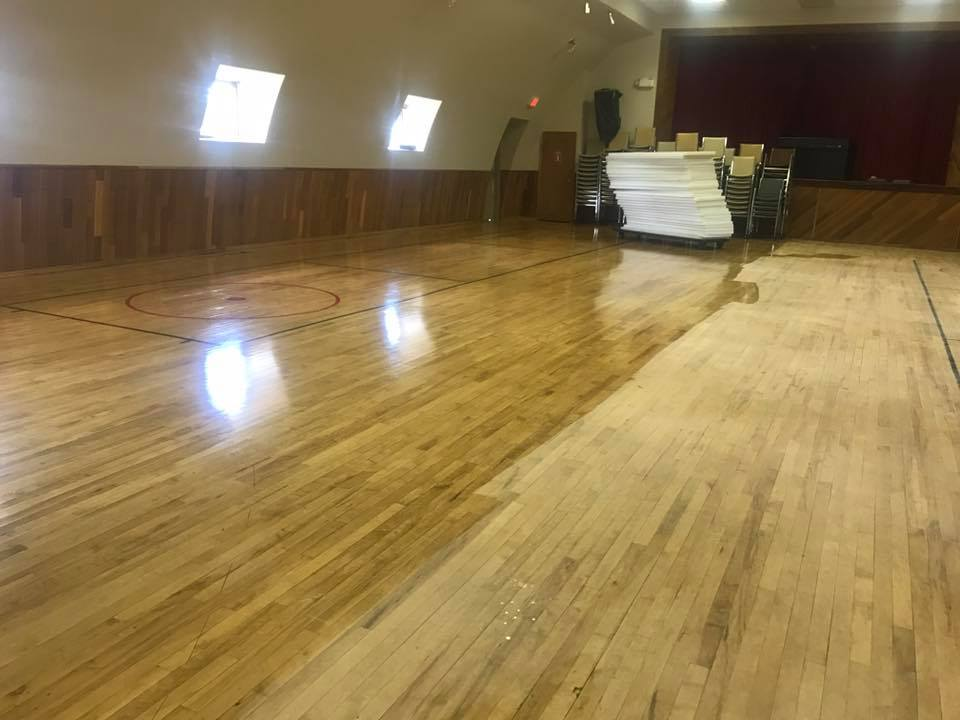 refinishing hardwood floors at hall