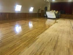 refinishing hardwood floors at hall