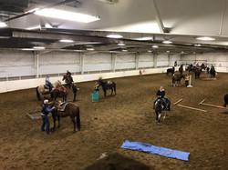 cowboy challenge riders in arena