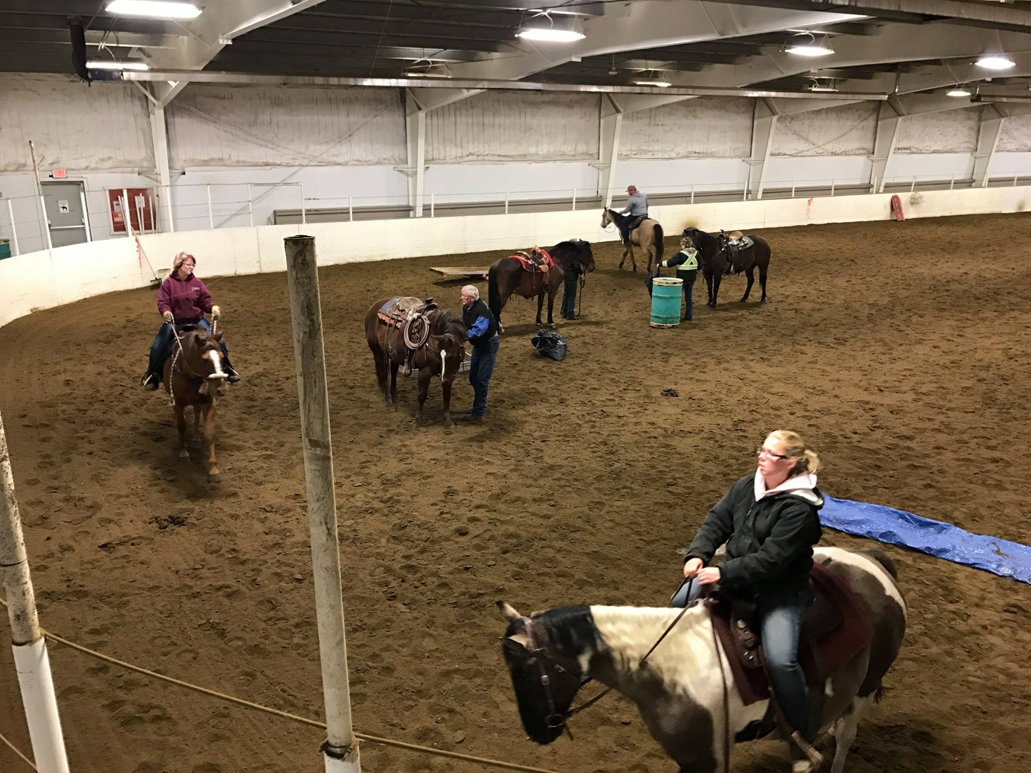 horse riders in arena