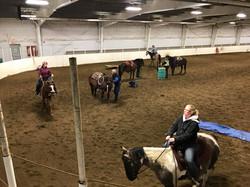 horse riders in arena