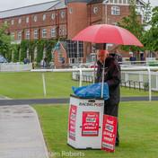 Racing Post Seller in the Rain
