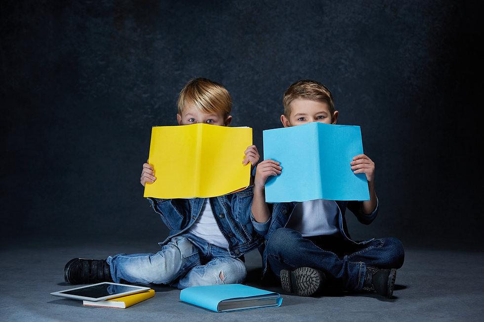 children-sitting-floor-with-books.jpg