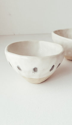 Ink spots - white ceramic cup with blurry ink spots