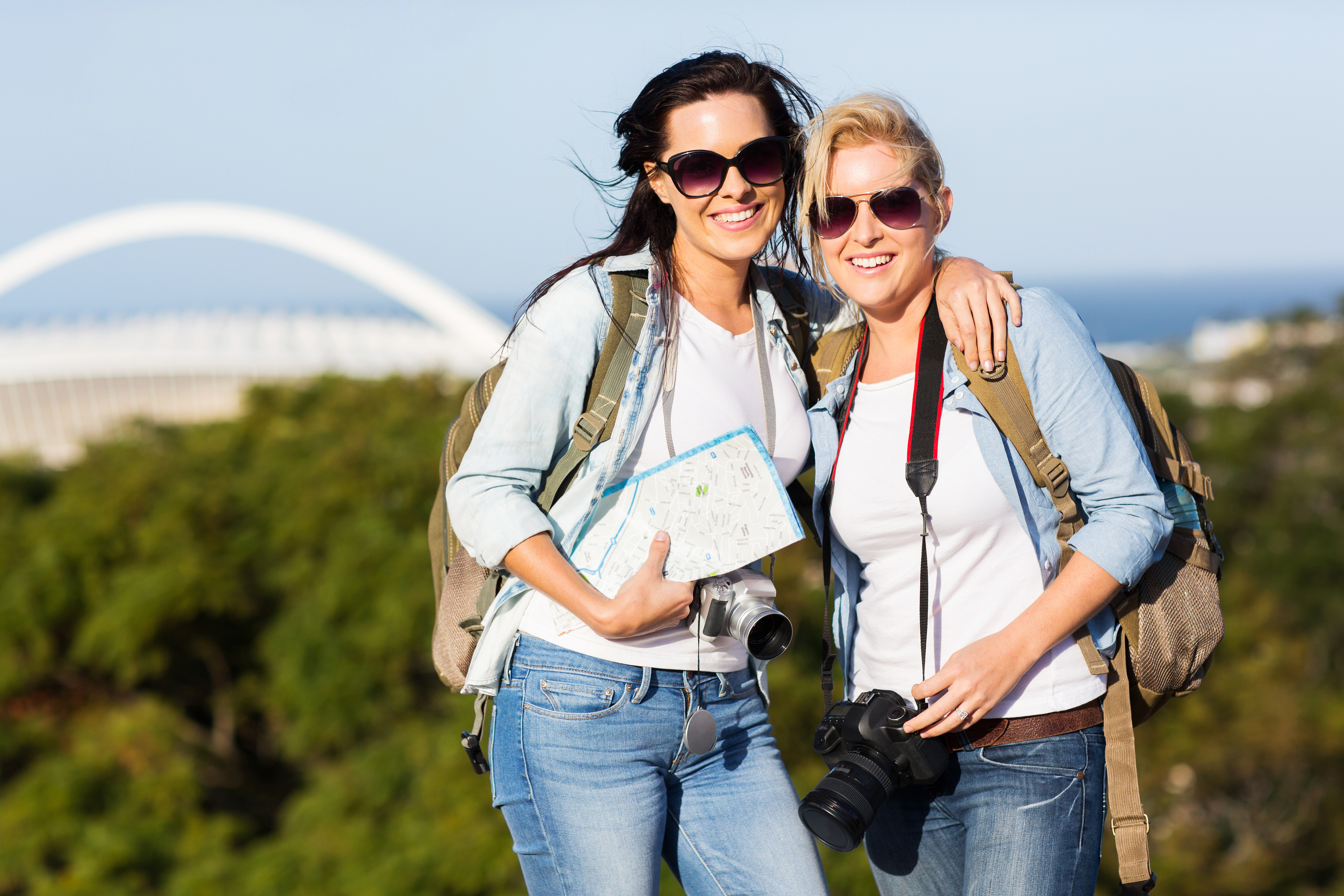 bigstock-two-beautiful-young-women-tour-