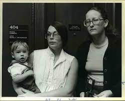 Gail O'Neil holding her ten month old son and Natyah Ottine's mother watching the court proceedings.