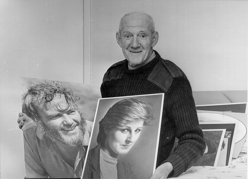 dad with portraits.jpg