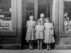 Mr McArthur and staff at his shop on the High Street. Think the wee boy may be Stuart Rutherford.   Courtesy of Christine McArthur