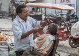 Open air barber, India