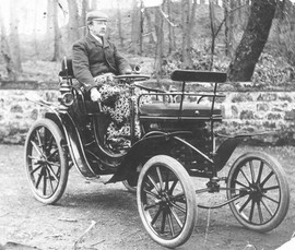 Peter Dewar was the first person to own a motor car in the village.  It is lacking a number of modern gadgets, bluetooth connectivity, USB port, heated front seats (the cover over his legs does not count) or SatNav. It does however have air conditioning - in spades.