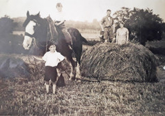Mr & Mrs William Buchanan, their son William on horseback and John MacKie holding the reins. Both boys attended the Lochwinnoch school.  Mr and Mrs Buchanan lived at the Kaim Dam. Mr Buchanan worked there. The photograph was taken at Longcroft Farm in Sept. 1941  Contributed by Mark Buchanan.