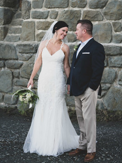 Bride and groom in front of the tower at Mt. Constitution on Orcas Island