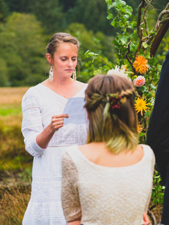 A moment of the bride reading her vows.