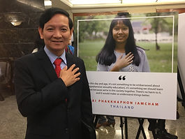 A policy maker from Cambodia at the opening of the Thai exhibition with Mai's photo