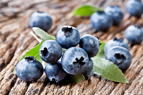 Blueberries with blueberry leaves on a o