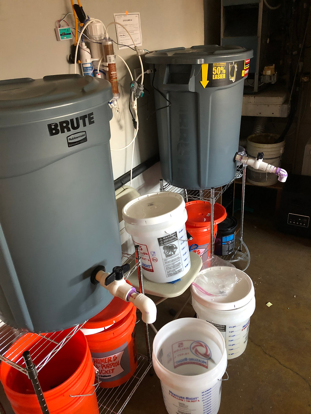 Salt water mixing station using two Brute trash cans, RO/DI unit and float valves
