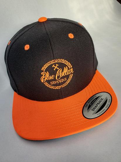 Neon orange and black snapback