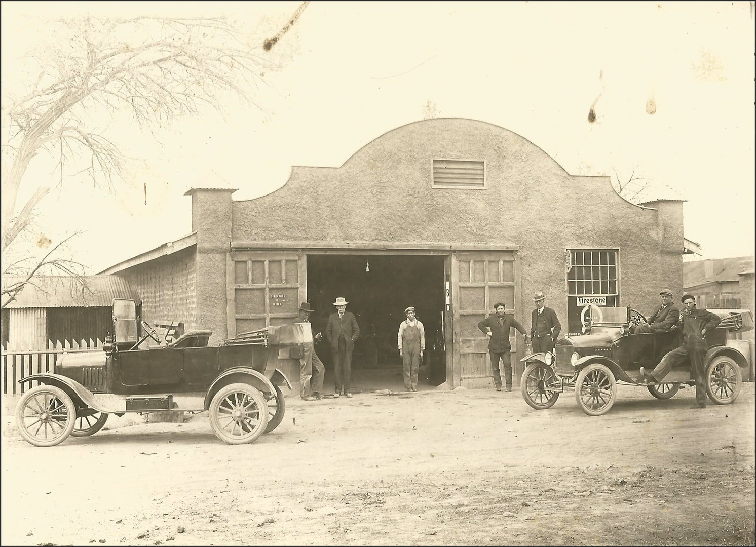 Matt Gilmore's City Garage. This fine business was located on St Francis (US Highway 54/70). Unfortunately, this facility was torn down in the 1950's. Automobiles were both 1915 Ford Model T Touring Editions.