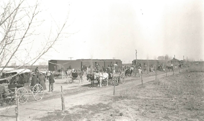 Meeting the railroad to deliver the crops to the market.