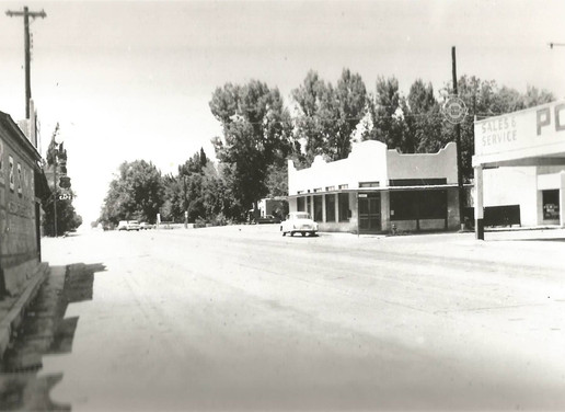 A historic view of our community looking northeast on US Highway 70 (also known as the Ozark Auto Trail) at the corner of 4th and Granado streets. A 1950 Chevrolet Deluxe Sedan is parked looking north.   https://goo.gl/maps/CDECQPWvZe52