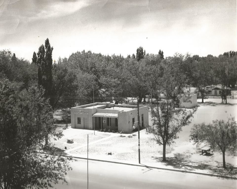Tularosa Chamber of Commerce.   A unique photograph perspective of the 1941 WPA built Tularosa City Hall. It appears this image was taken from the roof of the St Francis De Paula Catholic Church, across the street.