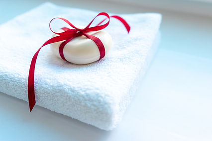 A piece of soap tied with a ribbon tied