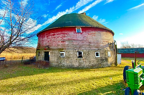 A Rare Round Barn for Sale with 30 + acres of Iowa land