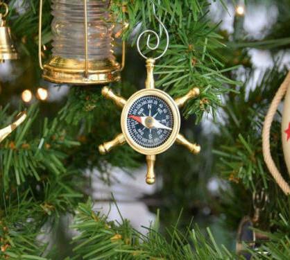 Brass ship's wheel compass ornament