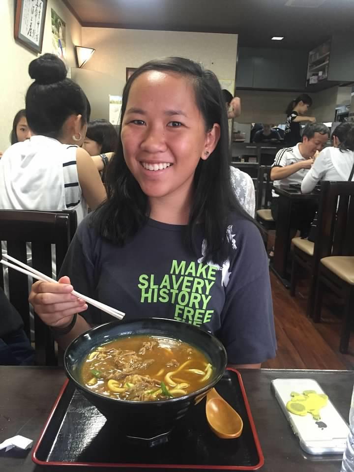 Enjoying her noodles