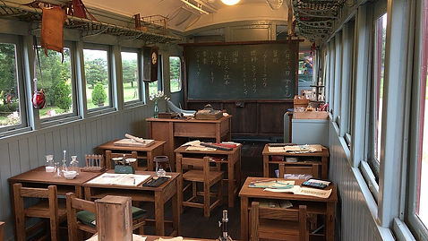 1200px-Old_railroad_cars_for_classrooms_