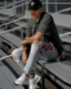 Artist & Diretcor PeeZee wearing 47brand & Carhartt Raiders hat
