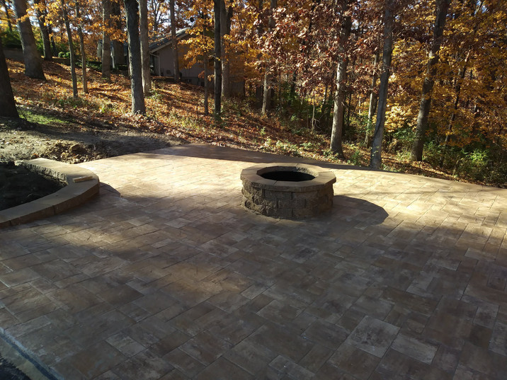 Paver patio, planter, and firepit