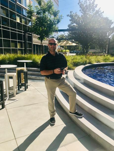 Robert in front of his office.