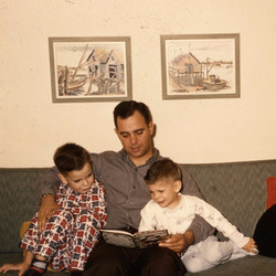 Dad reads to boys