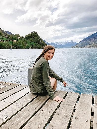 photographer sitting on dock