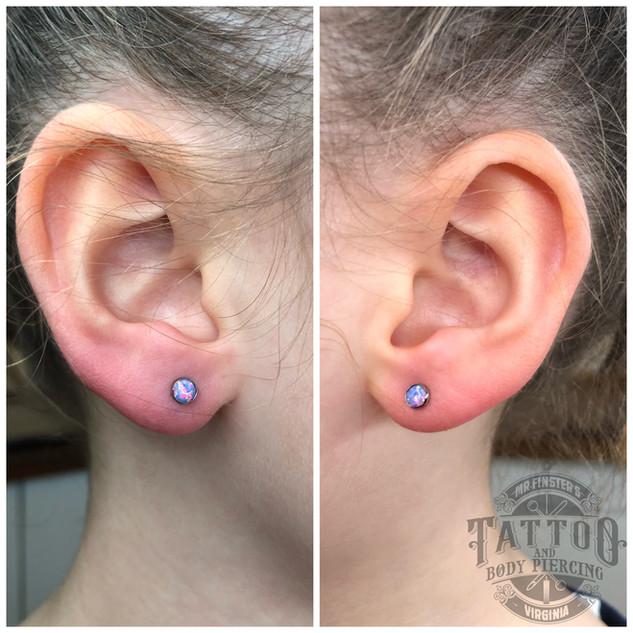 new earlobe piercings with lavender opal
